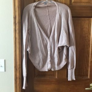 Champagne colored cardigan with silver sparkles.